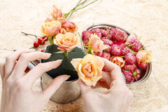 How to make floral arrangement in vintage watering can. Step by step Stock Image