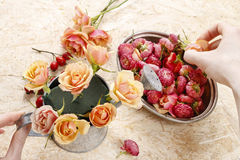 How to make floral arrangement in vintage watering can Stock Photography