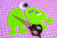 How to make a fun felt monster out of felt. Step. Sewing lesson Stock Photos