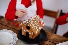 Kids make gingerbread house. stock photos