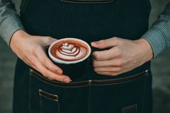 How to make latte art by barista focus in milk and coffee. In vintage color Stock Images