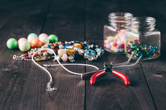 How to make necklace, fun handicraft. Bright fashion accessory handmade making Stock Photography
