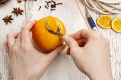 How to make orange pomander ball with candle - tutorial Stock Photos