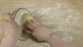 How to make a pizza. Pepperoni pizza. Making pizza batter by mixing flour, salt and olive oil. Creating round dough and filling it with sauce, cheese and stock video