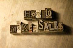 How to make sales - Metal letterpress lettering sign. Lead metal 'How to make sales' typography text illustration Stock Image