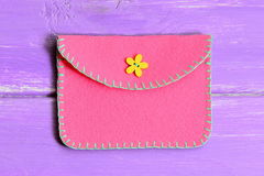 How to make a simple felt purse. Step. Quick and easy sewing crafts instruction. Handmade pink felt purse. Purse sewing pattern. Purse tutorial. Felt purse Royalty Free Stock Image