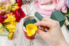 How to make spring bouquet of flowers in goose egg shell tutoria Royalty Free Stock Photos