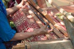 How to make Thai sedge mat. Traditional weaving dried sedge mat in Thailand stock photo