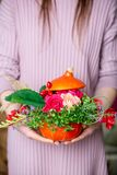 How to make a Thanksgiving centerpiece with big pumpkin and bouquet of flowers. stock photography