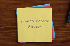 How to Manage Anxiety written on a note Stock Photos