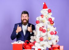 How to organize awesome office christmas party. Man bearded hipster wear formal suit near christmas tree. Checklist. Christmas preparation. Christmas gifts and royalty free stock images
