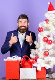 How to organize awesome office christmas party. Preparation and celebration. Man bearded hipster wear formal suit near. Christmas tree. Checklist christmas royalty free stock image