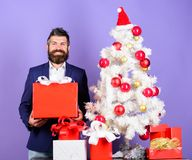 How to organize awesome office christmas party. Ready to celebrate. Christmas preparation and celebration. Man bearded. Hipster wear formal suit near christmas stock image