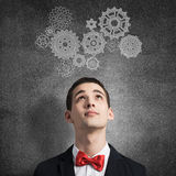 How to organize your work. Young man wearing red bowtie on background of teamwork concept Stock Images