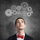 How to organize your work. Young man wearing red bowtie on background of teamwork concept Royalty Free Stock Photo