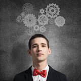 How to organize your work. Young man wearing red bowtie on background of teamwork concept Royalty Free Stock Photography