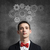 How to organize your work. Young man wearing red bowtie on background of teamwork concept Stock Photos