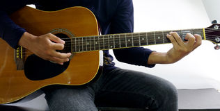 How to play a guitar C sus4 Stock Photography