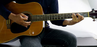 How to play a guitar. Chord C 7 Stock Image