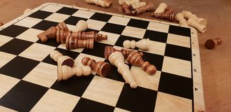 How to play wooden board game chess. Improvisation and Different angles of chess sets, pieces and chessboard. White and black figu royalty free stock image