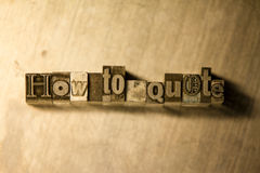 How to quote - Metal letterpress lettering sign. Lead metal 'How to quote' typography text on wooden background Stock Photography