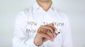 How To Reach Engagement, Businessman Writing on Glass. High quality stock photography