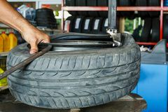 How to remove the tire from the car Alloy Wheels. Machine for removing rubber from the wheel disc How to remove the tire from the car Alloy Wheels Royalty Free Stock Image