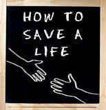 How to Save a Life on Chalkboard stock image