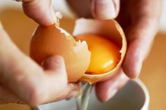 How to separate yolk and egg white Royalty Free Stock Images