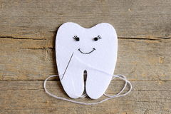 How to sew a felt tooth fairy. Step. Instruction for kids. Join the felt edges of felt tooth fairy with white thread. Vintage wood Stock Photography