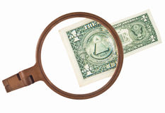 How to start financial crises. One dollar bill magnified by lens Royalty Free Stock Photography