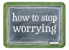 How to stop worrying - blackboard banner Stock Photo