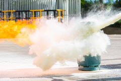 How to use a fire extinguisher with  gas container. Stock Image