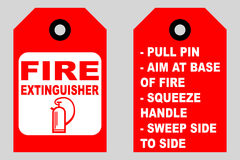 How to use a fire extinguisher informational tags front and back side Stock Photo