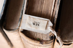 How To Win Concept. Text How To Win and old books, How To Win Concept Royalty Free Stock Photo