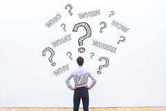 How where what when who questions. Businessman asking many questions, what, where, when, who and how, expert business advice concept stock photo