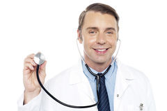 How are you feeling today ?. Doctor ready to do regular checkup of his patient. Closeup shot Stock Image