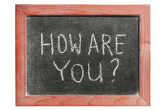 How are you. Question handwritten on isolated vintage chalkboard royalty free stock photography