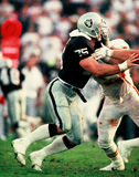 Howie Long. Oakland Raiders Hall of Fame Defensive End Howie Long. Film scan, visible grain Stock Image