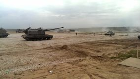 Howitzer go and stop at the military training ground stock video