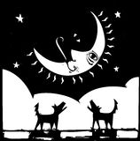 Howling. Two lonely dogs howling at a crescent moon with a face Royalty Free Stock Photo