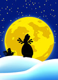 Howling of rudolph. Silhouette of santa claus and rudolph the reindeer howling like a wolf at full moon Stock Image