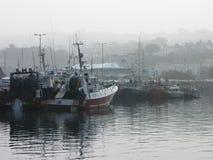 Howth Boats - Dublin, Ireland. Boats on a foggy day in Howth, Dublin Stock Images