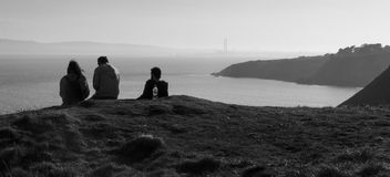 Howth, County Fingal, Ireland.  Scenic view of Dublin coast. People chilling and  looking at dublin`s coast from Howth Royalty Free Stock Image