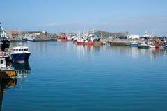 Howth harbour, Dublin,Ireland. Dublin, Ireland - September 21, 2014:Fishing boats docked in the Howth harbour, Dublin,Ireland Royalty Free Stock Photography