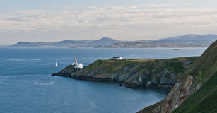 Howth peninsula lighthouse and Dublin bay. Picture taken of the lighthouse on the Howth peninsula with Dublin bay in the background Stock Images