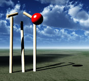 Howzat. A image of a cricket ball smashing a wicket Stock Image