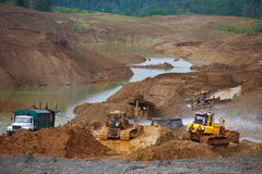 Hoyo de arena Special de la arena para la construcción Marque con hoyos por completo de pistas finas de la arena y del camión foto de archivo libre de regalías