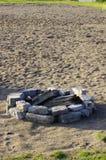 Hoyo del fuego en arena Fotos de archivo libres de regalías