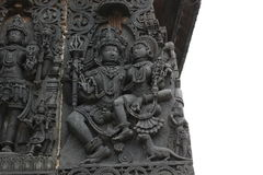 Hoysaleshwara Temple wall carving of lord shiva and parvati below is her mongoose Stock Image